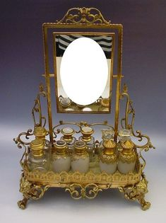 "Inspiration: Divine Antique French Bronze Perfume Vanity "" Mirror and Figural Feet"" from worldrarities on Ruby Lane"