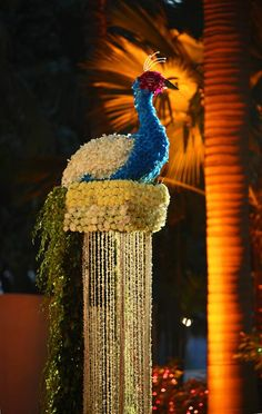 A gorgeous model of peacock made with flowers is adding a unique glamour to the wedding venue | wedding inspiration | wedfine.com |