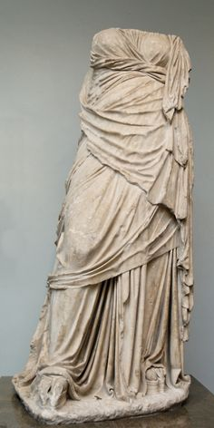 """Portrait of an unknown woman or statue of a Muse wearing a himation, 200-160 BC Greece, British Museum    Notice also that she's wearing platform sandals, referred to as the kothornos. They were originally worn by actors to increase their height in order to play certain characters, mostly in tragedies which lead to the genre being called """"cothurna"""". The height of the platforms, which could reach up to six inches, would cause the actors to have an unusual, swaying gait that women apparently…"""