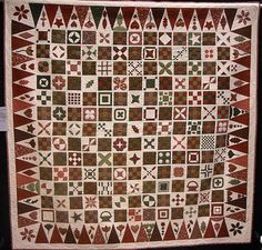Red and green Dear Jane quilt. It was made by a woman named Jan, so she called it Dear Jan