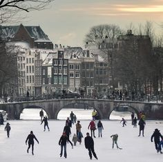Amsterdam's canals become all-natural ice-skating venues by B℮n, via Flickr