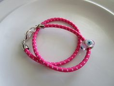 Pink and white double wrapped bungee cord bracelet with silver