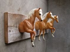 Three-palomino bridle or clothing rack. Handmade from adapted Breyer Model horses and reclaimed wood. $210.00.
