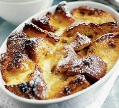 Panettone pudding - a posh version of bread and butter pudding, rich with cream and vanilla, recipe http://www.bbcgoodfood.com/recipes/1358/panettone-pudding#