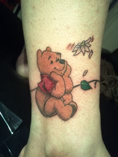 Winnie the pooh on ankle with vine tattoo