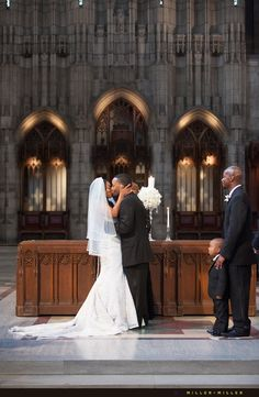 bride groom kissing Rockefeller memorial chapel University of Chicago wedding | Photos by Chicago Photographers Miller + Miller Wedding Photography www.mmfotos.com
