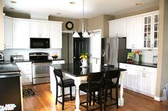 Love this kitchen! I'm obsessed with having a huge island in my next home.