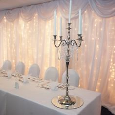 Magical twinkle back drops for the top table.