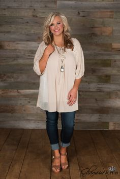 Southern Queen Top is so sweet! This peasant style top features a round neckline with keyhole, tie closure and gathered detailing around the yoke.