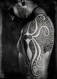Negative space octopus in this neo tribal shoulder tattoo by Peter Madsen.