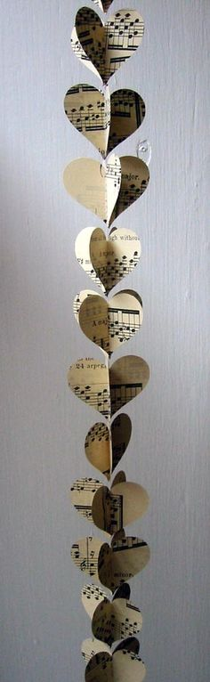 "This sweet and delicate mini paper heart garland is made from vintage sheet music. Each 30"" garland is made of 40 hearts doubled up so they can be folded back to create 20 3D hearts. They can bemachine stitched or glued together. Each heart measures 1.5"" high x 2"" wide."