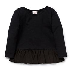 100% Cotton Slub tee. Long sleeve t-shirt with a peplum hem. Regular fitting silhouette with snap buttons on left shoulder for easy dressing. Available in Black.