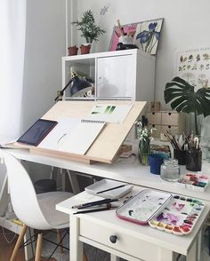 Lovely workspace for an art desk in the home office / art studio space. Desktop easel / drafting table surface plus cabinets and drawers to keep art supplies. My New Room, My Room, Bureau D'art, Desk Inspo, Workspace Inspiration, Inspiration Boards, Bedroom Inspiration, Art Desk, Office Decor