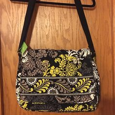 NWT Vera Bradley Messenger Bag NWT, great bag for school or work.  Front snap-buckle closure, interior pockets, two zippered pockets inside front under messenger flap, zippered pocket in back. Vera Bradley Bags