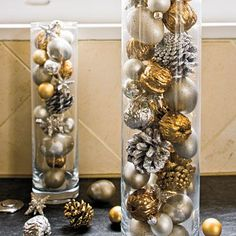 Fill column vases with ornaments or silver and gold sprayed small natural items (nuts, little pinecones). Dollar Tree has these vases for only one dollar, although they're a small version, but could be grouped by the half dozen and raised to different levels with stacks of coasters or something underneath.