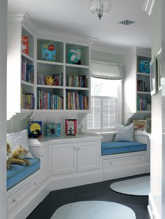 Children's Built-In Library, Window Seating with Blue Padded Cushions (Scott Sanders)