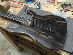 Ormsby Guitars  Ebony top. Shark inlay