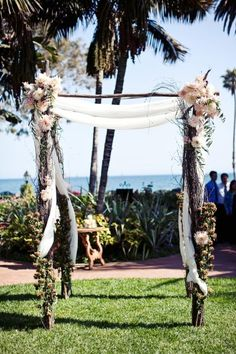 this is the huppah style we would like but instead of these flowers we would like something like star jasmine