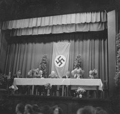 In July 1937, the Mormon Prophet Heber J. Grant, spoke to 800 members at a rented meeting hall in Frankfurt. Like all buildings in Nazi Germany, it came with a large swastika flag. On Aug. 7, the Deseret News, the Church-owned Salt Lake City daily, ran this picture. In its news columns, the DN regularly published wire service stories about Hitler's treatment of Germany's Jews. But in the religion section, it had no qualms about associating the Church President with Nazi symbolism. Meeting Hall, German People, University Of Oklahoma, Mind Over Matter, Lds Church, Latter Day Saints, Social Issues, World History, Book Publishing