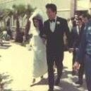 Elvis and Priscilla leaving the Aladdin in Las Vegas on their wedding day.