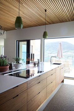 Make It Work: Smart kitchen design solutions for narrow galley kitchens cabinet open cubbies above the cabinets for stashing cookbooks and infrequently used appliances. small kitchen decor for kitchen ideas & inspiration. Modern Kitchen Interiors, Contemporary Kitchen Design, Home Decor Kitchen, New Kitchen, Home Kitchens, Kitchen Ideas, Modern Kitchens, Smart Kitchen, Kitchen Modern