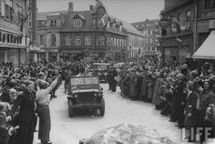 Happy crowd lines the streets of Copenhagen to welcome American troops after the German occupying forces were driven out. Denmark, May 1945.