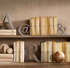 Metal letters from Pottery Barn. Book bindings homemade. Love this vibe, calming & simple