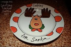 Kids hand prints as antlers on a cookies for Santa plate