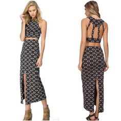Free People Textured Two Piece Textured and printed crop top and maxi skirt set in a lightweight easy fabric. Round neckline and sleeveless construction. Open caged back design. Maxi skirt has a slit in back with an elastic waistband. 97% cotton, 2% elastic, 1% spandex. Retail: $148 Free People Dresses Midi