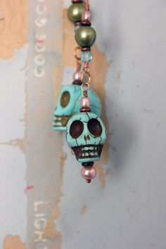 Day of the Dead earrings - Dia De Los Muertos jewelry - Halloween earrings - skull earrings - fresh water pearl earrings. $38.00, via Etsy.