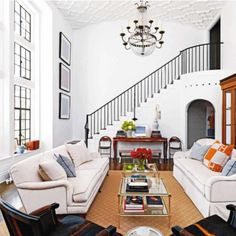 love the staircase, ceiling, chandaleir, and windows