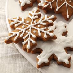 Gingerbread Snowflakes Recipe -Cutting my favorite gingerbread cookie dough into snowflake shapes and decorating them with white icing was ideal for my theme get-together. I save these crunchy treats to enjoy on the way home from our Christmas tree outing. —Shelly Rynearson, Oconomowoc, Wisconsin