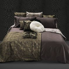 Bring this exotic pattern into your bedroom with the Roberto Cavalli Home Africa King Duvet Cover Set. This print features hints of leopard on a bold black background. The set includes a duvet cover, fitted sheet and 2 pillowcases. Create the perfect look for your bedroom with this beautifully crafted duvet set.