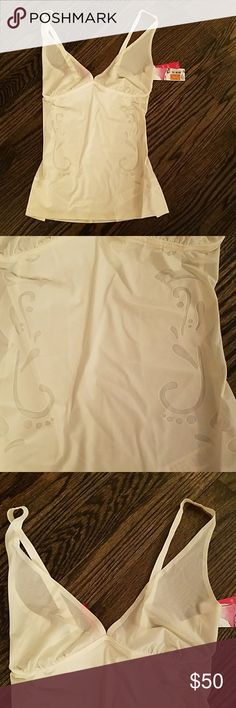 Spanx Bridal Undergarmet Haute Contour deep plunge camisole with medium slimming.  Deco inspired laser cut design details. Smoothing, fine guage microfiber for all around shaping. Sexy look and comfortable fit the color is Pearlized White. SPANX Intimates & Sleepwear Shapewear