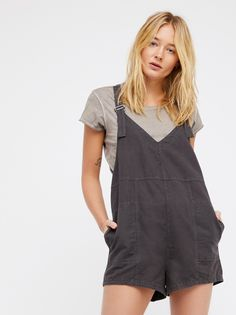 Summer Getaway Romper | In a comfortable linen-cotton blend fabrication, this simple V-neck romper features large side pocket details and adjustable straps.