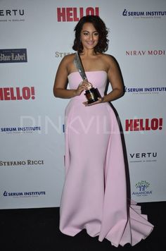 Sonakshi Sinha arrived wearing a pink gown at HELLO! Hall of fame awards. She surprised everyone with this look of hers. With curled up hair, she sported a different look.