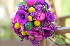 """A beautiful design by Tulipina""  Anemones, Lilacs, Ranunculus, and Craspedia http://fb.com/tulipinadesign"