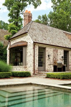 """""""We created this curved, steel-framed window to give Marcia a window seat,"""" says Peter. The copper roof, popular during the Middle Ages, will mellow over time.    Love it? Get it!Roof: cedar shake"""