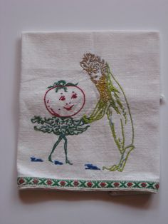 Vintage hand embroidered anthropomorphic cloth dancing.
