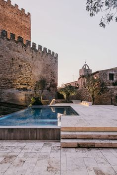 Completed in 2015 in Peratallada, Spain. Images by Salva Lopez. The Peratallada Castle, located in the Baix Empordà (Catalonia, Spain) and considered for it's historic-artistic value a National heritage building,. Castle Pictures, Cool Swimming Pools, Unique Gardens, Outdoor Living, Outdoor Decor, Private Garden, Garden Stones, Decks, Landscape Design