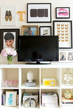 Tv stand styled with books and gallery wall