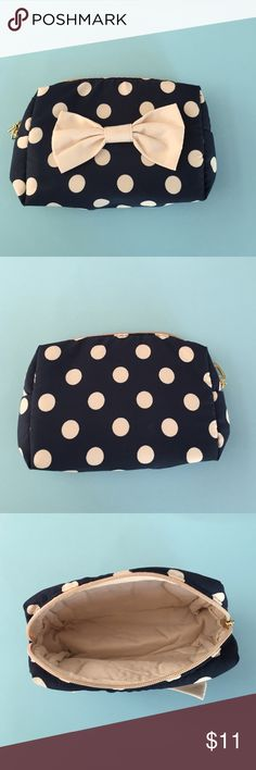 HOST PICK Blue & white polka dot makeup bag Love this cute make up bag!  Super soft fabric with cute gold zipper and heart clasp!  Measures 6 inches wide and 4 inches tall. Bags Cosmetic Bags & Cases