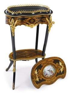 A pair of Transitional style gilt-bronze mounted kingwood, satinwood and green stained fruitwood table ambulantes France, early century, after the model by Charles Topino Furniture Styles, New Furniture, Antique Furniture, Empire, Bronze Mirror, Antique Boxes, Marquetry, French Furniture, France