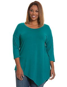 The asymmetric hem is the must try-trend of the season, and in a soft  knit there's nothing not to love about this chic tunic. Detailed with a  flattering scoop neck and 3/4 sleeves. lanebryant.com