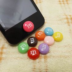 M Chocolate Beans Candy Home Button Sticker for iPhone 3,4,4s,5,ipad 2,3,4,iPod Touch 2,3,4,5. $2.49, via Etsy.