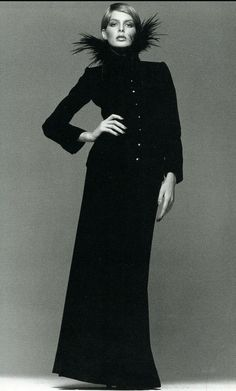 1974-75 Rene Russo in a black velvet evening suit with a dramatic feather collar from YSL FallWinter collection