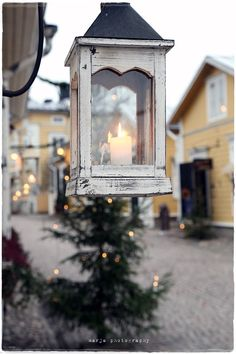 Lighting the Christmas streets by candle light