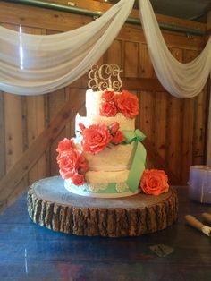Four Tier Wedding Cake with Coral Roses and Mint Ribbon with Delicate Lace trim.