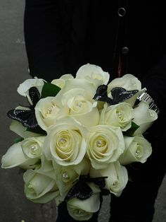 A beautiful bridal bouquet of cream roses with delicate black butterflies - #weddingflowers that represent you and make your wedding unique. We'd love to hear from you if you have any questions about flowers for your special day - give us a call on 0161 861 0524 and we'll be happy to help!