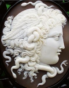 Head of Medusa Cameo, Italian 1880    In history, cameo only referred to works where the relief image was of a contrasting color to the background; this was achieved by carefully carving a piece of material with a flat plane where two contrasting colours met, removing all the first color except for the image to leave a contrasting background.